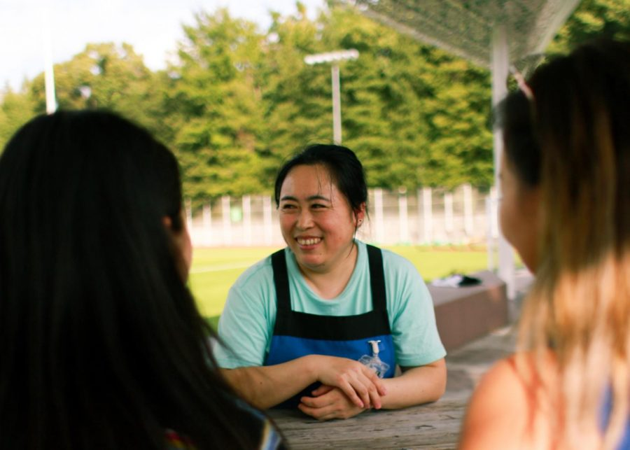 "Senior Dohyun Kim and sophomore Lauren Hartz interview Ms. Xiaolin Yanzi, one of the janitorial staff. Take a chance this week to show your gratitude and extend a warm ""thank you"" to a member of ASIJ's janitorial staff."
